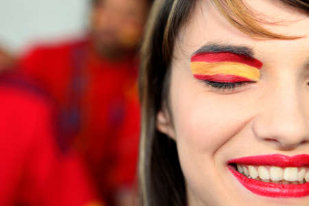 face paint: Woman supporting the Spanish football team Stock Photo