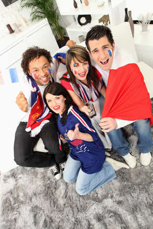 group of French football fans celebrating photo