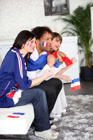 French football fans watching a televised match photo