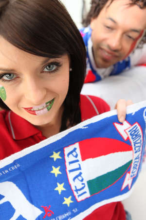 nationalists: Couple supporting the Italian soccer team