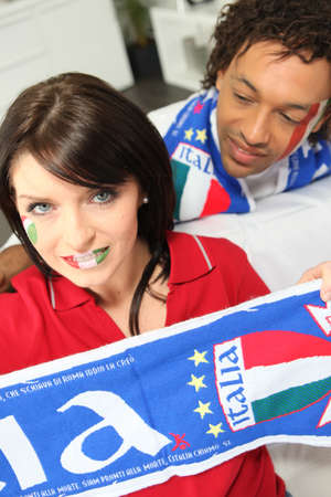 Couple supporting the Italian soccer team photo