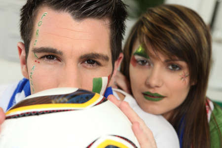 Couple supporting the Italian football team photo