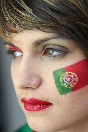 Woman supporting the Portuguese football team photo