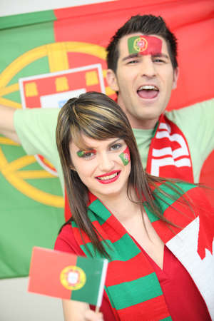 highlighted hair: Portuguese football supporters Stock Photo