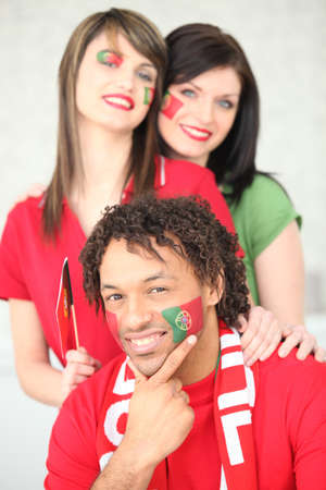 Three Portuguese football supporters photo
