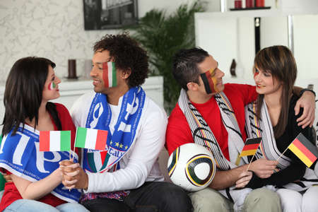 Italian and German soccer fans Stock Photo - 14208371