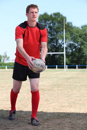 man playing rugby photo