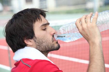 Tennis player drinking water Stock Photo - 14207556