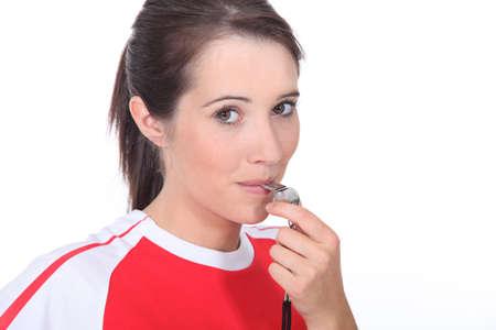 whistles: Female referee
