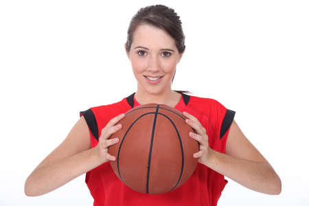 invariable: a young female basket-ball player Stock Photo