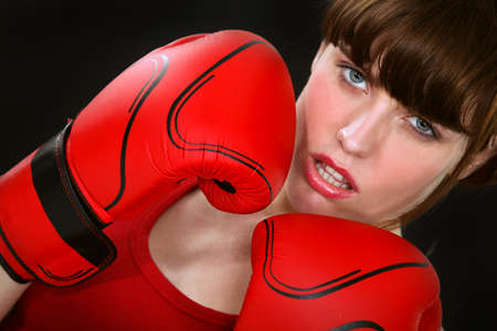 Gorgeous woman with boxing gloves photo