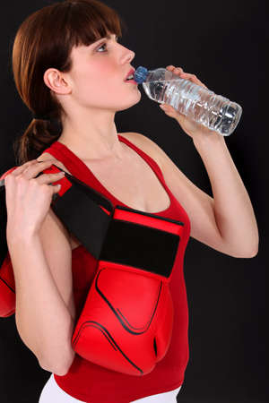 Female boxer drinking from water bottle Stock Photo - 14207582