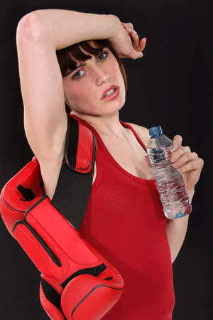 Female boxer drinking a bottle of water photo