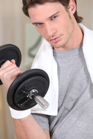 Determined man with a dumbbell photo