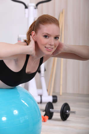 perspire: young woman doing stability ball abs exercises