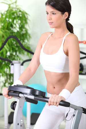 Woman on a treadmill photo