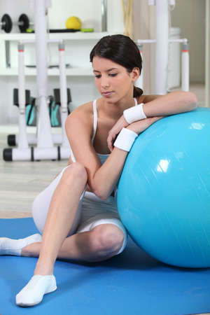 jilted: Woman sitting with an exercise ball Stock Photo