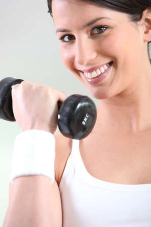 stress free: Young woman with hand weights