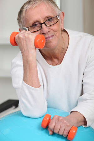 maintained: Old woman with oranges weights Stock Photo
