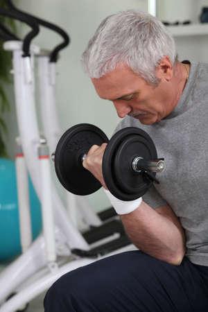 vertical wellness: Mature man doing sports Stock Photo
