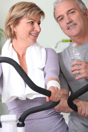 Mature couple at the gym photo