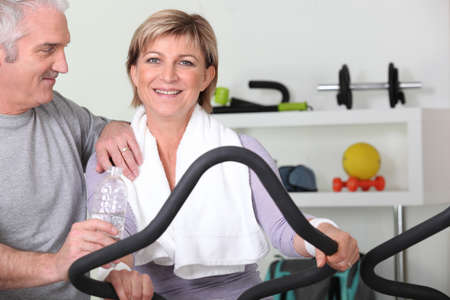 perspire: senior couple training in the gym