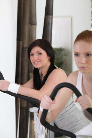 static bike: Two women at the gym Stock Photo