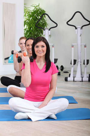 Three women working out together at the gym Stock Photo - 14208934