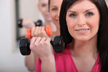 Women lifting dumbbells photo