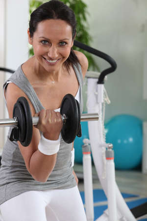 heavy lifting: Woman using a dumbbell