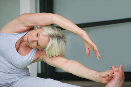 senior woman doing exercises photo