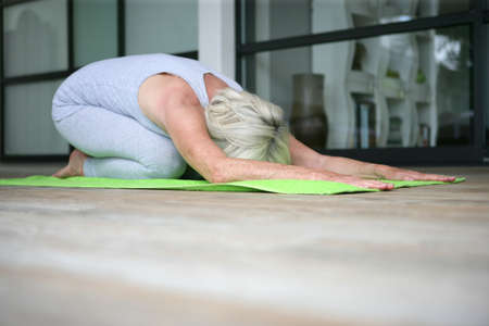 Middle-aged woman doing yoga photo