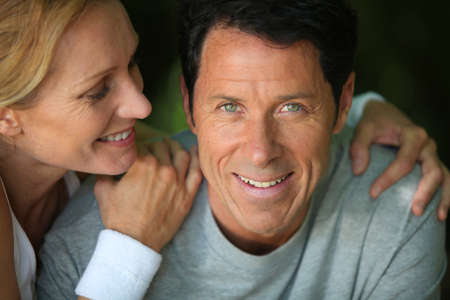 flattery: Middle-aged couple smiling Stock Photo