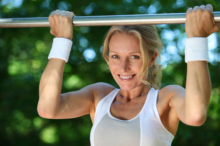 outdoor fitness: Woman circuit training Stock Photo