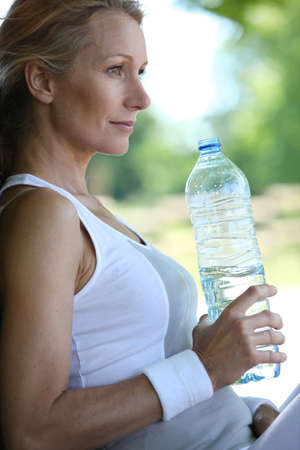 Woman drinking water Stock Photo - 14210312