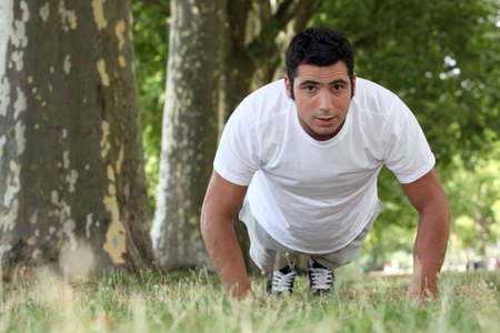 hardiness: muscular man doing push-ups in a park