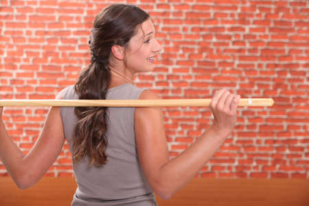 Woman exercising with a stick photo