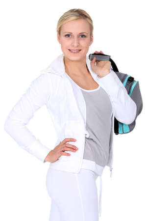 tracksuit: Woman with gym bag