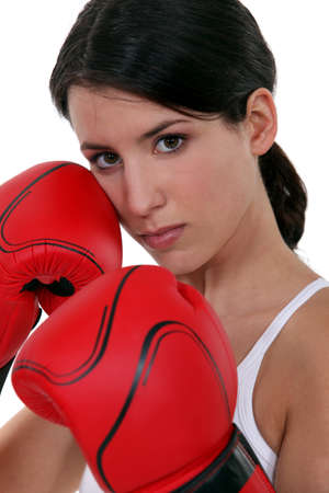 Tough woman with her boxing gloves Stock Photo