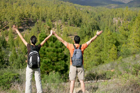 teen couple: Hikers appreciating the view