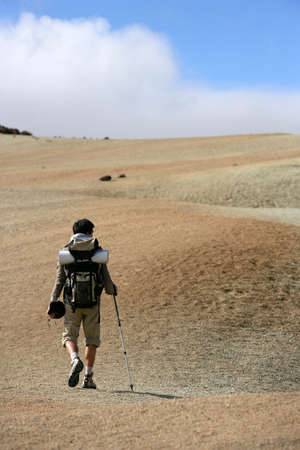 Man backpacking in the steppe photo