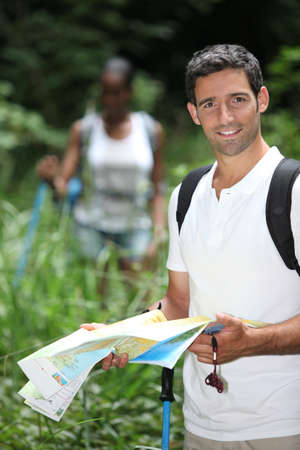 orienteering: Couple  hiking with a map Stock Photo