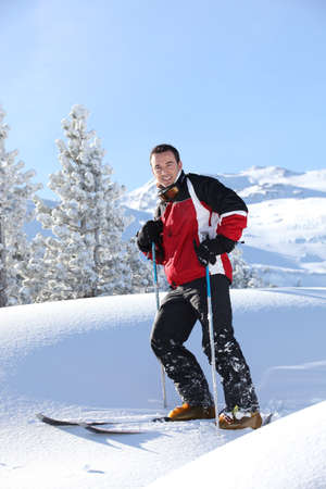 Man skiing alone photo