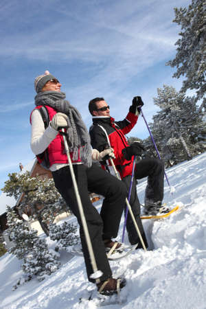 snowshoeing: Couple snow-shoeing