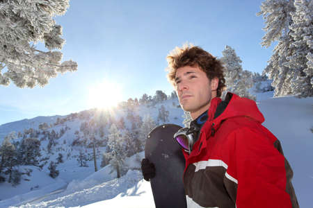 Man stood with snowboard photo