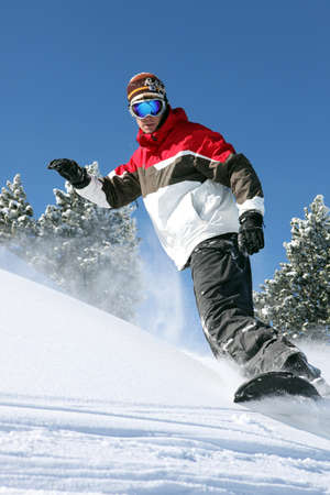 snowboard: Snowboarder in action Stock Photo