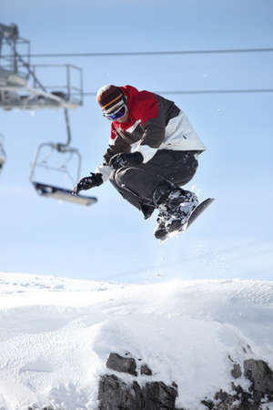 midair: A snowboarder in mid-air Stock Photo