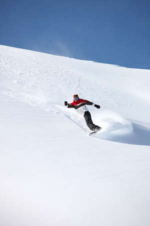 spaying: Snowboarder spaying snow