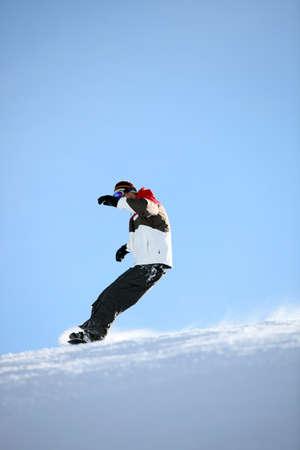 Man snowboarding photo