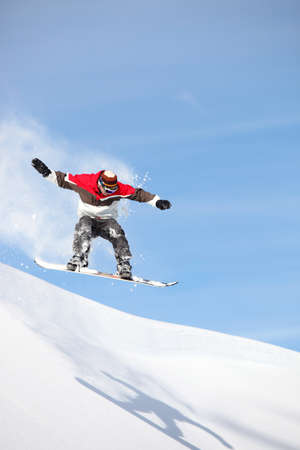 Snowboarder performing impressive jump photo